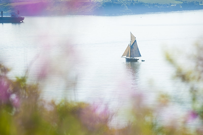 Sailing from St. Anthony Head to Falmouth, photo by Adam Gibbard courtesy of Visit Cornwall.
